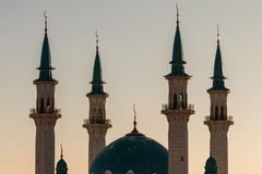 Mosque silhouette at sunset stock image