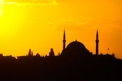 Mosque silhouette at sunset orange sky light Royalty Free Stock Photos