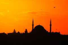 Mosque silhouette at sunset red sky light Stock Photography