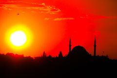 Mosque silhouette at sunset red sky light Stock Image