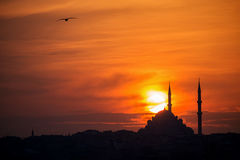 Mosque silhouette on The sunset and two minarets Royalty Free Stock Photo
