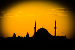 Mosque silhouette at sunset with a vignette Royalty Free Stock Photo