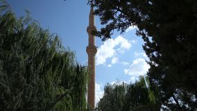 Mosque minaret and sky. Mosque, sky and one minaret stock video footage