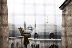 Mosque Skyline (window view). View from a window of the Hagia Sophia in Istanbul, Turkey Royalty Free Stock Image