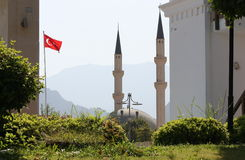 Mosque. The spiers of a mosque on a background of mountains in Turkey Royalty Free Stock Photo