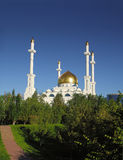 Mosque in summer greenery Stock Photo
