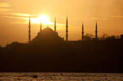 Mosque and The Sun Stock Photography