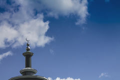 Mosque of Sunni Muslims 1. Mosque of Sunni Muslims. Minaret against the blue sky with white clouds Royalty Free Stock Image