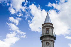 Mosque of Sunni Muslims 5. Mosque of Sunni Muslims. Minaret against the blue sky with white clouds Stock Photography