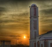 Mosque and sunset stock photo