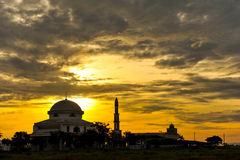 A mosque with the sunset. View near the paddy field Royalty Free Stock Image