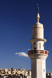 Mosque tower. Tower of a mosque with the city of Amman, the capital of Jordan, as a backdrop Stock Photos