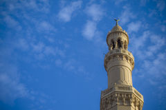 A mosque tower. Reaching to the sky royalty free stock photo