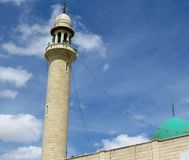 Mosque tower and dome Stock Images