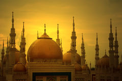 Mosque tower minaret. Tower minaret of a mosque at sunset royalty free stock image