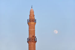 Mosque tower and moon royalty free stock photos