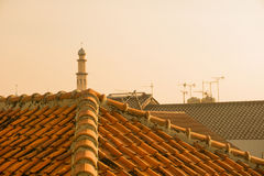 Mosque tower with warm color photo and tile roof top taken in depok jakarta indonesia stock photography