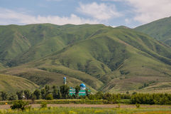 Mosque under mountains. Mosque located at the foot of the mountains Royalty Free Stock Photo