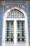 Mosque window. Old mosque window with blue Turkish Iznik tiles Royalty Free Stock Photo