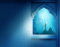 .Mosque window with shiny crescent moon Royalty Free Stock Images