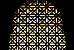 Mosque windows latticework. Ornament lattice window in Mosque of Cordoba, Andalusia, Spain Royalty Free Stock Photography