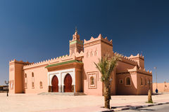 Mosque Zagora, Morocco. The mosque in Zagora, Morocco with a palm tree in the foreground stock photography
