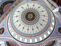 Mosques. Dome mosque decorated with ornaments, mosaics and inscriptions Stock Photography
