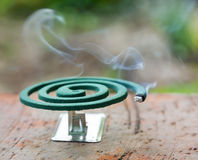 Mosquito coil. Burning mosquito coil is an anti-mosquito repellent Stock Photography