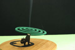 Mosquito coil incense smoke Royalty Free Stock Images