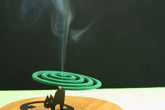 Mosquito coil incense smoke. Mosquito coil insect repellent burning and smoking Stock Photos
