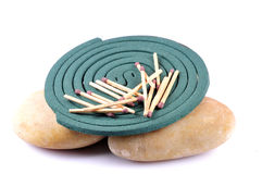 Mosquito coil with matchsticks Royalty Free Stock Photography