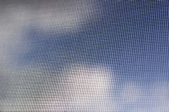 Mosquito grid. Clouds and the sky through a mosquito grid Royalty Free Stock Image
