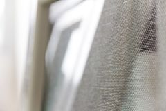 Mosquito net. Close up of mosquito net and window background Stock Photos