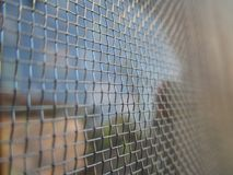 Mosquito net. Provides protection from mosquitoes, flies, and other insects, and that way against the diseases that they can transmit. Examples of diseases as stock image