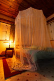 Mosquito netting. Mosquito net over a bed at night in the tropics Royalty Free Stock Photos