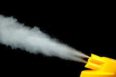 A mosquito spray in action Royalty Free Stock Photo