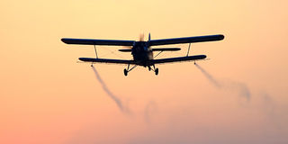 Mosquito spraying plane Stock Image