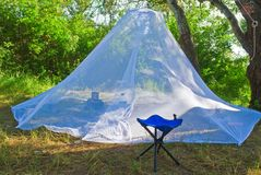 Mosquitoes tent and a chair Stock Photos