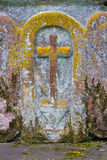 Moss covered cross. Old moss covered cross, carved in red sand stone along a road in Kollesleuken, Germany Stock Image