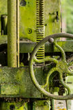 Moss covered farm machinery with handle Royalty Free Stock Images