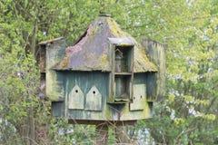 Moss Covered Giant Birdhouse Stockfotografie