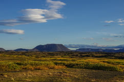 Moss covered lava field and volcano mount near lake Myvatn summe Stock Photos