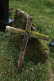 Moss covered old wooden cross Stock Images