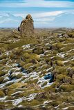 Moss-covered rock outcroppings in the Eldrhaun lava fields of Iceland. With mountains and glaciers in the background stock image