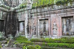 Moss-covered stone temple ruins near Angkor Wat, Siem Reap, Cambodia Royalty Free Stock Photography