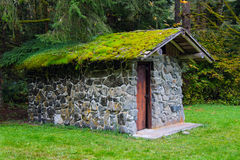 Moss-Covered Stone Well House Stock Photo