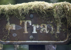 Moss covered trail sign Stock Images