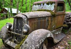 Moss covered truck. Abandoned moss covered rusted Royalty Free Stock Photography