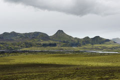 Moss field with volcanic crater in a distance, lakagigar, Icelan Stock Photography