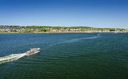 Moss sea bay with motorboat - ferry view Royalty Free Stock Photography